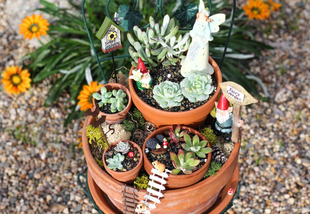 Place your fairy garden among the other plants in your yard!
